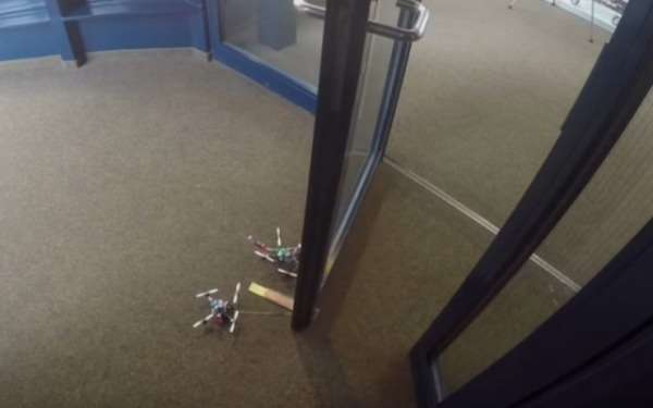 Drone robot carries weights and opens doors