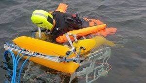 Autonomous robot emerging from the seabed to save drowning people